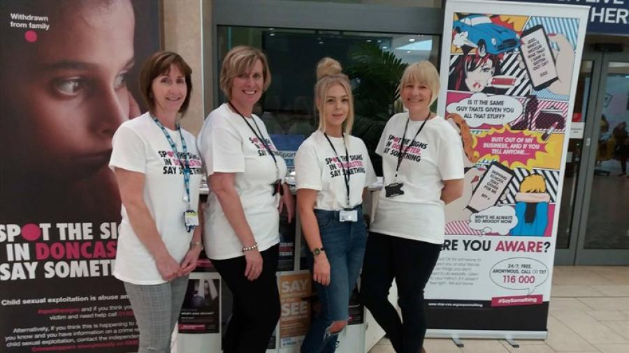 At the stand (from the left) are: Jayne Pezzulo, a specialist nurse with RDaSH (Rotherham Doncaster and South Humber NHS Foundation Trust ); Deborah Hartwell, Doncaster Children's Services Trust social worker in the CSE team; Parice Walden, student social