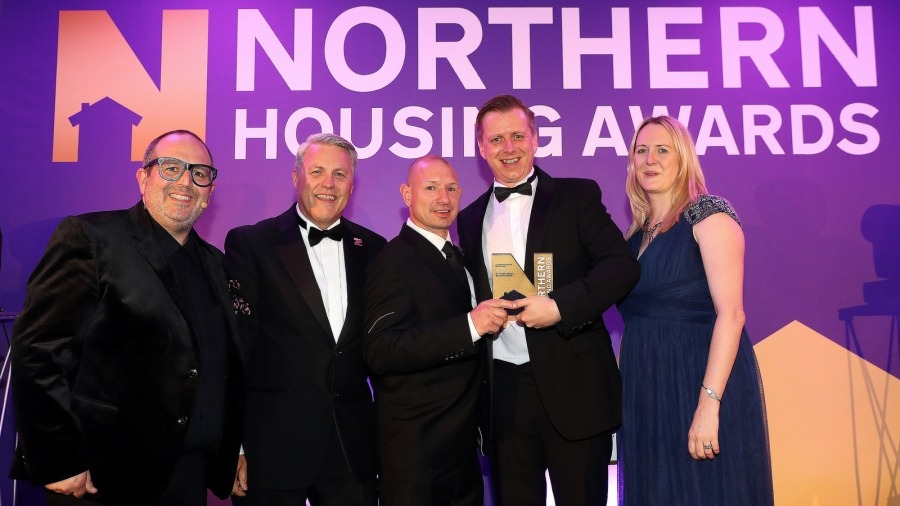 The team collecting the award for Best Partnership scheme.