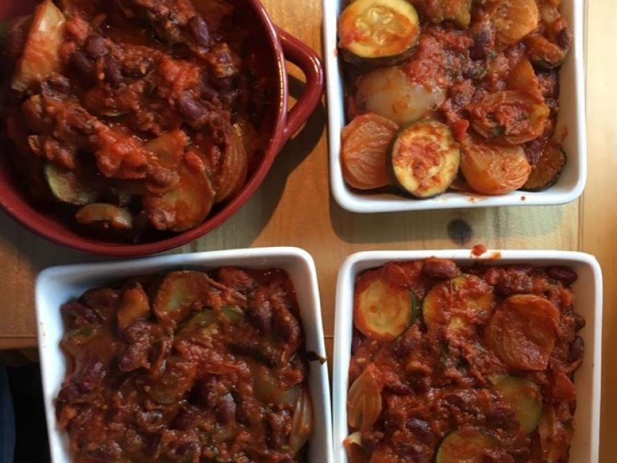 Four portions of homemade vegetable chilli.