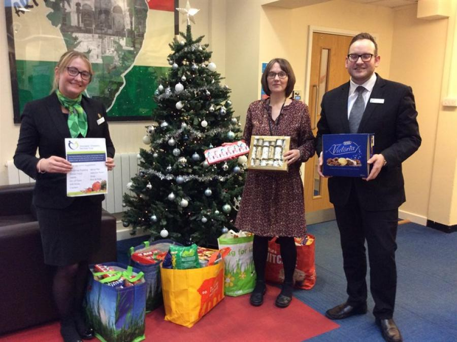 : Food glorious food – Yorkshire Building Society customer consultant Amanda Walker (left) and customer representative Antony Leone hand over items for the food hampers to Trust team manager Lisa Wilson.