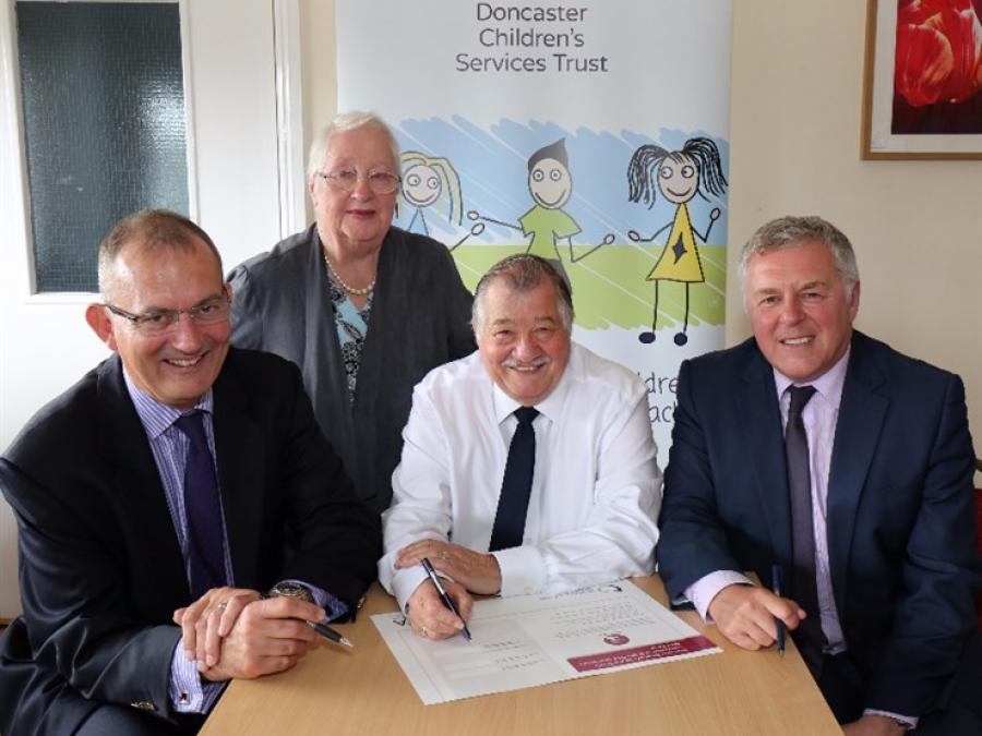Chair of Trust Colin Hilton, Mrs Bobbie Roberts, Chair of the Trustees at Doncaster Deaf Trust, Dr Terry Riley, Chair of the British Deaf Association and Chief Executive of the Trust Paul Moffat