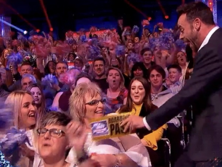 Foster carer receiving her golden boarding pass from Ant & Dec