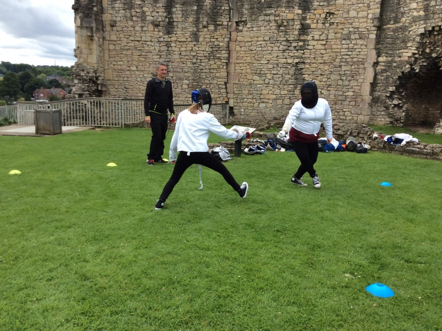 Young people enjoying EPIC activities at Conisbrough Castle in the summer.