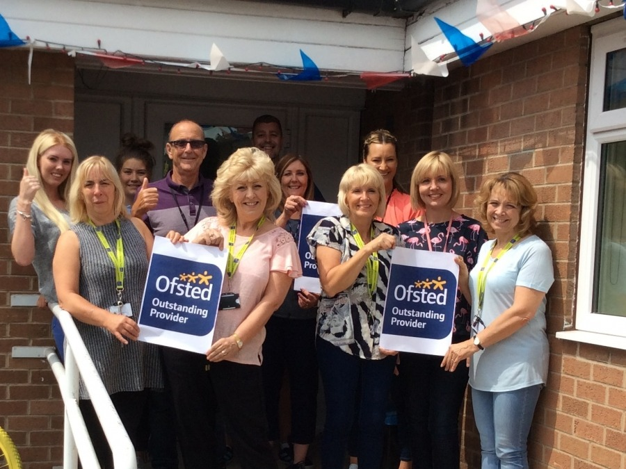 Staff at Oaklands short break home celebrate after receiving an Ofsted outstanding rating.