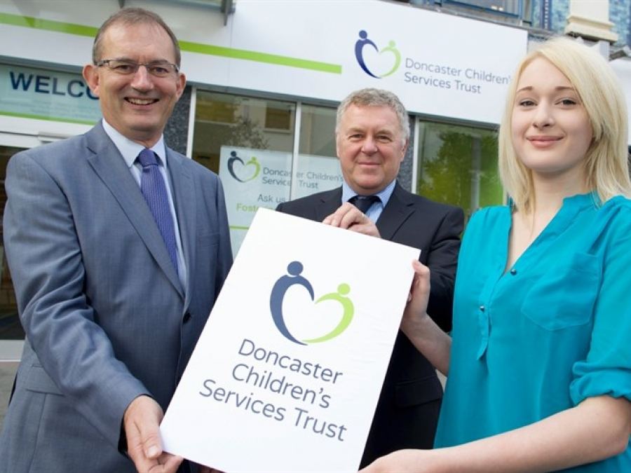 Trust Chair Colin Hilton, Trust Chief Executive Paul Moffat and design student Sophie Maxwell showcasing the Trust Brand