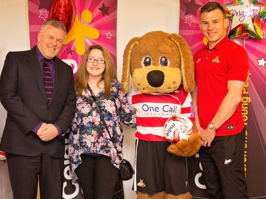 Doncaster Children's Service Trust Chief Executive Paul Moffat, Candice Wilson, Donny the Dog and Rovers player Andy Butler.