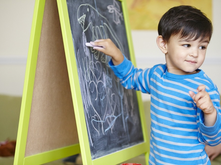 child at a chalkboard