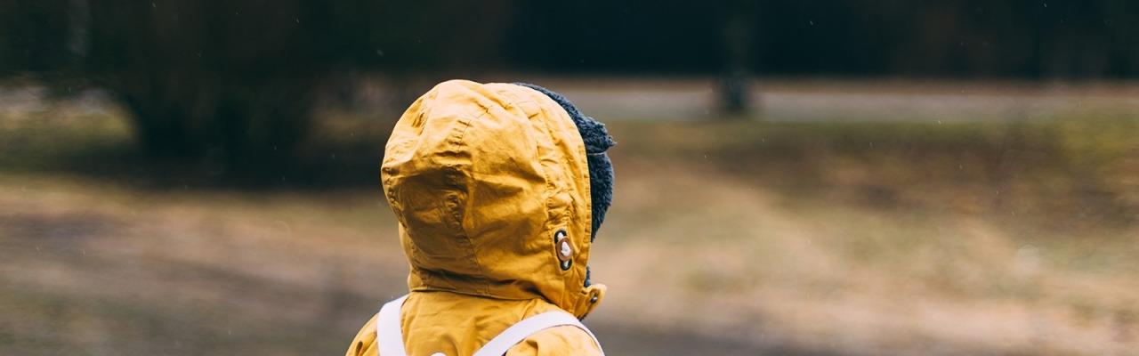 Toddler in yellow jacket